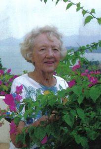 Photo of Joan in a garden